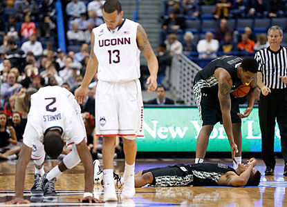 DeAndre Daniels, who shakes off a collision with Loyola's Dylon Cormier, goes on to finish with 21 points and eight rebounds. (USATSI)