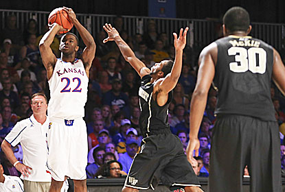 Andrew Wiggins finishes with 17 points as the Jayhawks prevail after blowing a 14-point halftime lead. (USATSI)