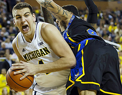 Michigan's Mitch McGary returns to the starting lineup, scoring six points with eight rebounds. (USATSI)
