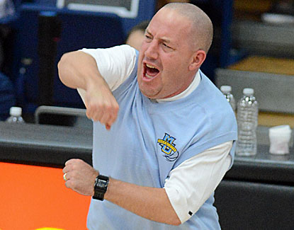 Marquette coach Buzz Williams is all fired up as his Golden Eagles hold GW to 35 percent from the floor in a 76-60 win. (USATSI)