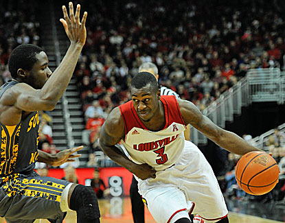 Louisville's Chris Jones drains four 3-pointers, scoring 18 off the bench in the Cards' blowout win over Southern Miss. (USATSI)