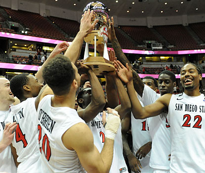 San Diego State players embrace their championship trophy after closing out Marquette with a 14-4 run. (USATSI)