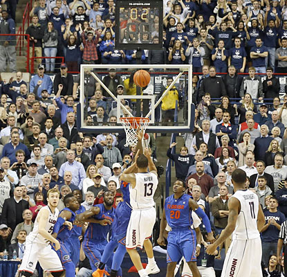 Shabazz Napier, who overcomes an ankle injury, knocks down the winning basket as time expires against Florida. (USATSI)