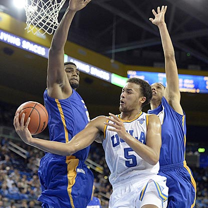 Bruins sophomore Kyle Anderson, shown passing around a Gauchos defender, scores 21 points and adds a game-high nine assists.  (USATSI)