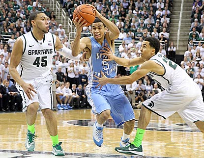 North Carolina guard Marcus Paige drives between Michigan State's Denzel Valentine and Travis Trice during the first half.  (USATSI)