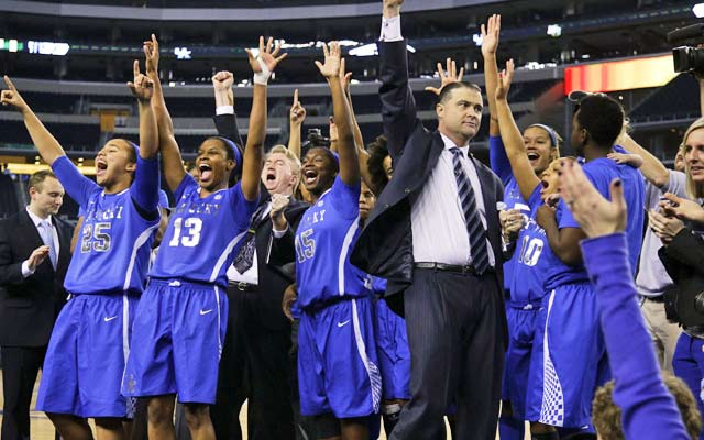 The No. 5 Wildcats celebrate a victory in the highest scoring women's D-1 game in history. (Getty Images)