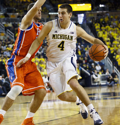 Michigan's Mitch McGary goes in for two of his 12 points as the Wolverines cruise to an easy win over the Huskies. (USATSI)