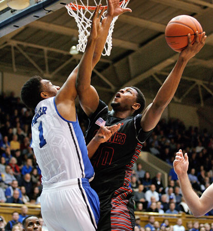 Jabari Parker, who scores 21 in the Blue Devils' win, defends against Gardner Webb's Tyrell Nelson. (USATSI)