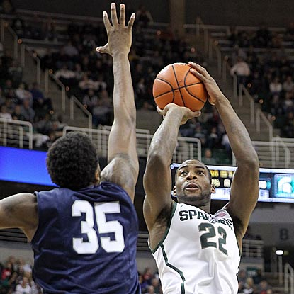 Michigan State's Branden Dawson, who winds up with 12 points, shoots over North Florida's Chris Davenport in the second half.  (USATSI)