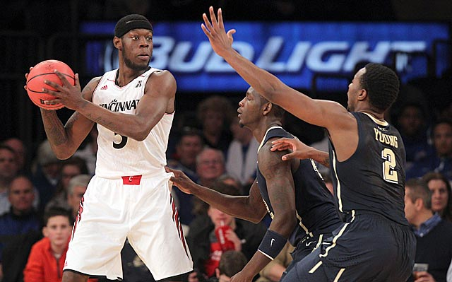 Justin Jackson (left) and the Bearcats stand up to Pittsburgh and win at Madison Square Garden.