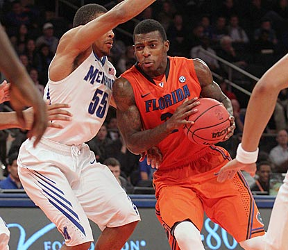 Casey Prather, shown driving against Geron Johnson, takes over down the stretch and scores Florida's final eight points.  (USATSI)