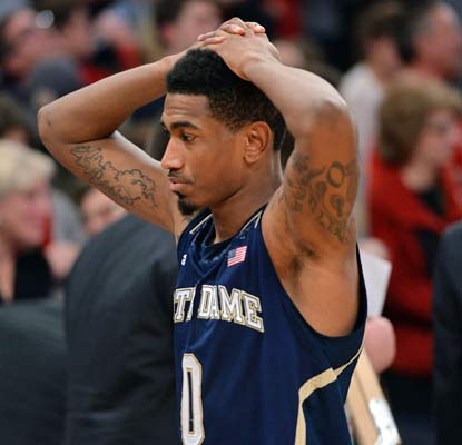 Eric Atkins and the Fighting Irish can't believe they let a late eight-point lead slip away at the Garden. (USATSI)