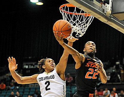 Oklahoma State's Markel Brown scores 23 points with 11 boards as the No. 7 Cowboys handle No. 20 Colorado in Las Vegas. (USATSI)