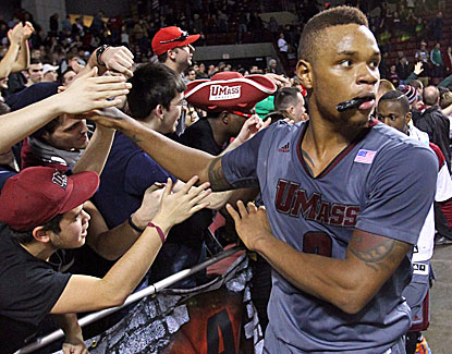 Derrick Gordon puts in the winning bucket with 1.1 seconds left in overtime to lead UMass to a tight win over Providence. (USATSI)