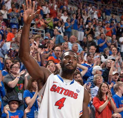 Florida fans salute Pat Young for becoming the 50th Gator to reach 1,000 points in his career.  (USATSI)