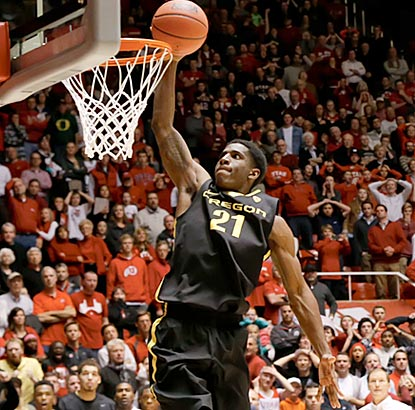 Oregon's Damyean Dotson scores on a breakaway dunk in the final moments to ruin Utah's upset bid.  (USATSI)