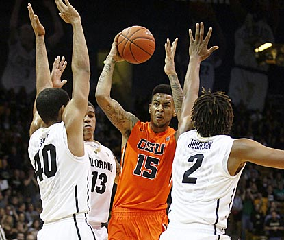 Beavers forward Eric Moreland (15) finds himself surrounded by a trio of Buffaloes defenders in the first half.  (USATSI)