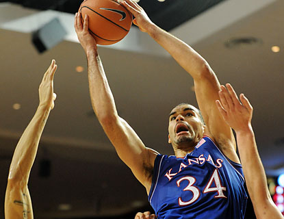 Perry Ellis scores 22 points and brings down a game-high 11 rebounds as the Jayhawks open Big 12 play with a W. (USATSI)