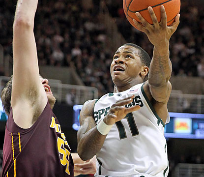 Keith Appling's Spartans score 15 straight points in the second half to jump in front of the Golden Gophers for good. (USATSI)