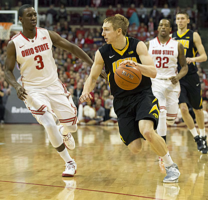 Mike Gesell (11 points) drives past Ohio State's Shannon Scott during the Hawkeyes' 84-74 win over the No. 3 Buckeyes.  (USATSI)