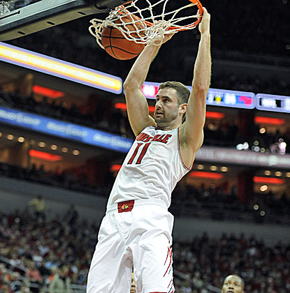 Luke Hancock dunks two of his career-high 23 points as 12th-ranked Louisville holds off Southern Methodist. (USATSI)