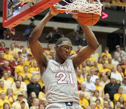 Joel Embiid throws down two of his 16 points as the Jayhawks stay perfect in the Big 12. (USATSI)