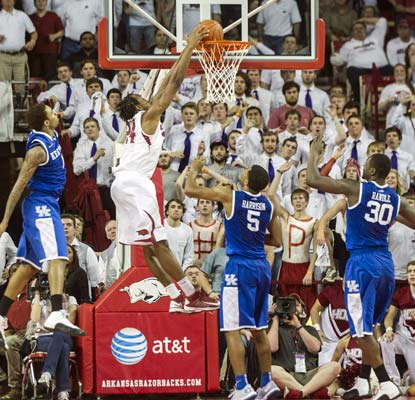 Arkansas clinches the dramatic win when Michael Qualls slams home a rebound with 0.2 seconds left in overtime.  (USATSI)