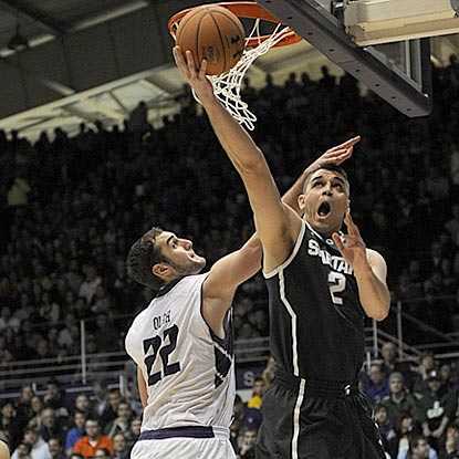 Michigan State reserve forward Alex Gauna drives around Northwestern's Alex Olah during the second half.  (USATSI)