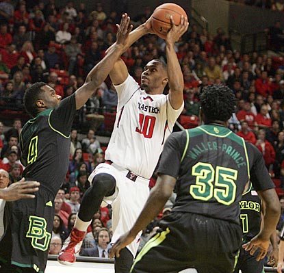 Jaye Crockett, who leads Texas Tech with 19 points, shoots over Baylor's  Gary Franklin during the second half.  (USATSI)