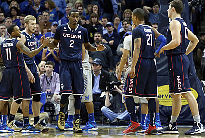 DeAndre Daniels (No. 2) has 23 points on 9-of-15 shooting and a career-high 11 rebounds to carry the Huskies. (USATSI)