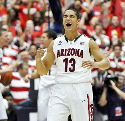 Arizona's Nick Johnson enjoys himself in a blowout victory over Arizona State where he scores 17 points.  (USATSI)