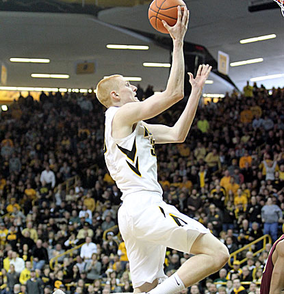 Iowa's Aaron White goes up for two of his 18 second-half points to lead the Hawkeyes past Minnesota. (USATSI)