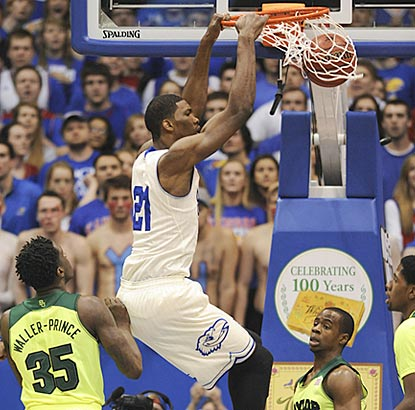 Kansas freshman center Joel Embiid dunks in the first half as Baylor's Taurean Prince watches.  (USATSI)