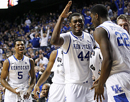 Kentucky's Dakari Johnson (44) celebrates with Alex Poythress (22) as the Wildcats pull away from Texas A&M in SEC action. (USATSI)