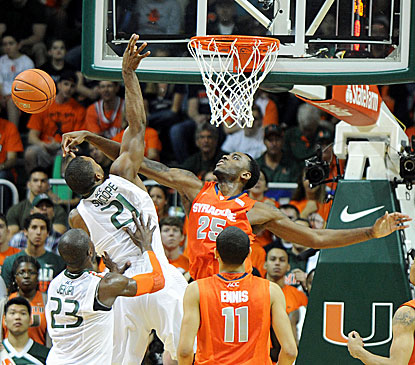 Syracuse's Rakeem Christmas (right) blocks the shot of Miami's Erik Swoope during the first half of the Orange's win. (USATSI)