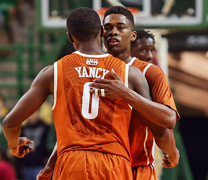 Isaiah Taylor, who scores a career-high 27 points, embraces Kendal Yancy as the Longhorns stay hot in Waco. (USATSI)