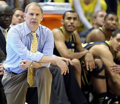 John Beilein's Wolverines go on a late 10-0 run to win their third straight game against a top-10 team. (USATSI)