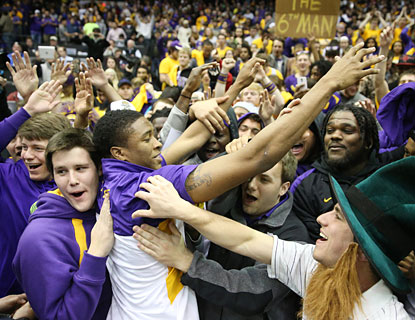 LSU fans -- at least those that brave the winter weather -- celebrate after their Tigers knock off No. 11 Kentucky. (USATSI)