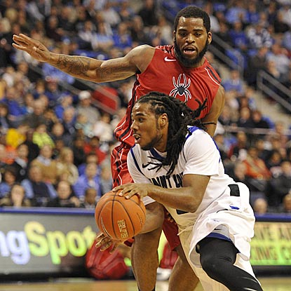 Billikens guard Jordair Jett, who records a double-double, drives around Spiders forward Derrick Williams in the second half.  (USATSI)
