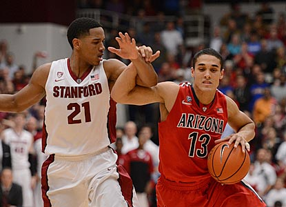 Nick Johnson and top-ranked Arizona work their way past Anthony Brown and Stanford in the second half.  (USATSI)