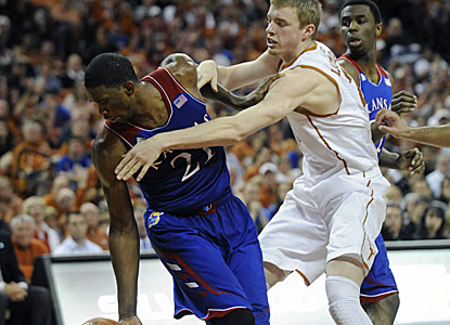 The Longhorns hold the Jayhawks -- the Big 12's best shooting team -- to 39 percent en route to their sixth straight victory. (USATSI)