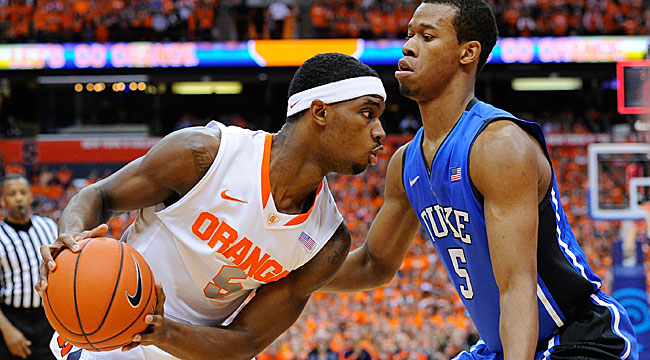 CJ Fair guarded by Duke's Rodney Hood.