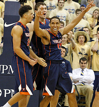 Malcolm Brogdon (right) celebrates with teammates after nailing a 3-pointer at the buzzer to knock off Pitt. (USATSI)