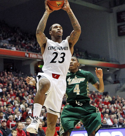Sean Kilpatrick scores 10 of his 18 points in the closing minutes to lead the Bearcats to a five-point win over South Florida. (USATSI)