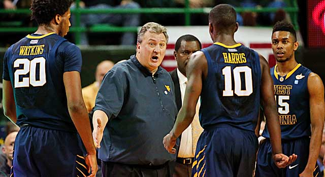 Bob Huggins gets the Mountaineers' attention during a timeout. (USATSI)