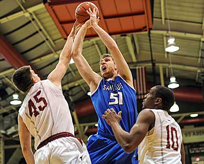 Rob Loe, who leads the Billikens with 17 points, shoots over Hawks forward Halil Kanacevic during the first half. (USATSI)