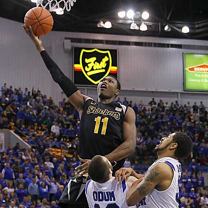 Cleanthony Early, shooting over Jake Odum here, scores a game-high 19 for Wichita State, including a clutch three-point play. (USATSI)
