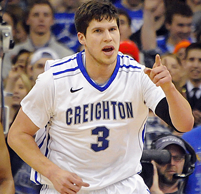 Doug McDermott continues his player of the year quest, scoring 32 points to help Creighton hold off DePaul.  (USATSI)