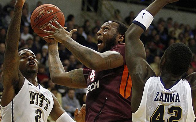 Cadarian Raines of Virginia Tech tries to split the Pitt defense. (Getty)