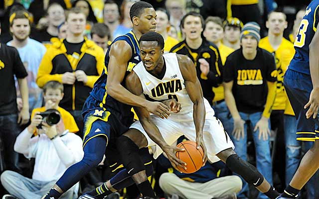 Iowa's Gabriel Olaseni looks for room against Michigan's Glenn Robinson III. (USATSI)